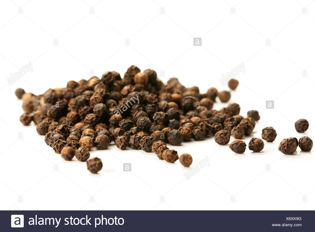 black peppercorns with wooden scoop - Stock Image