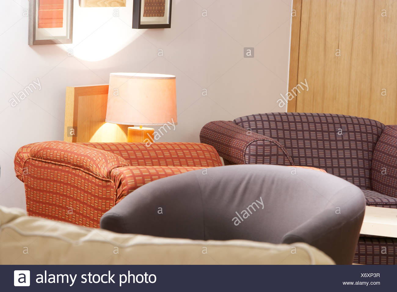 large comfy sofas in a restaurant - Stock Image