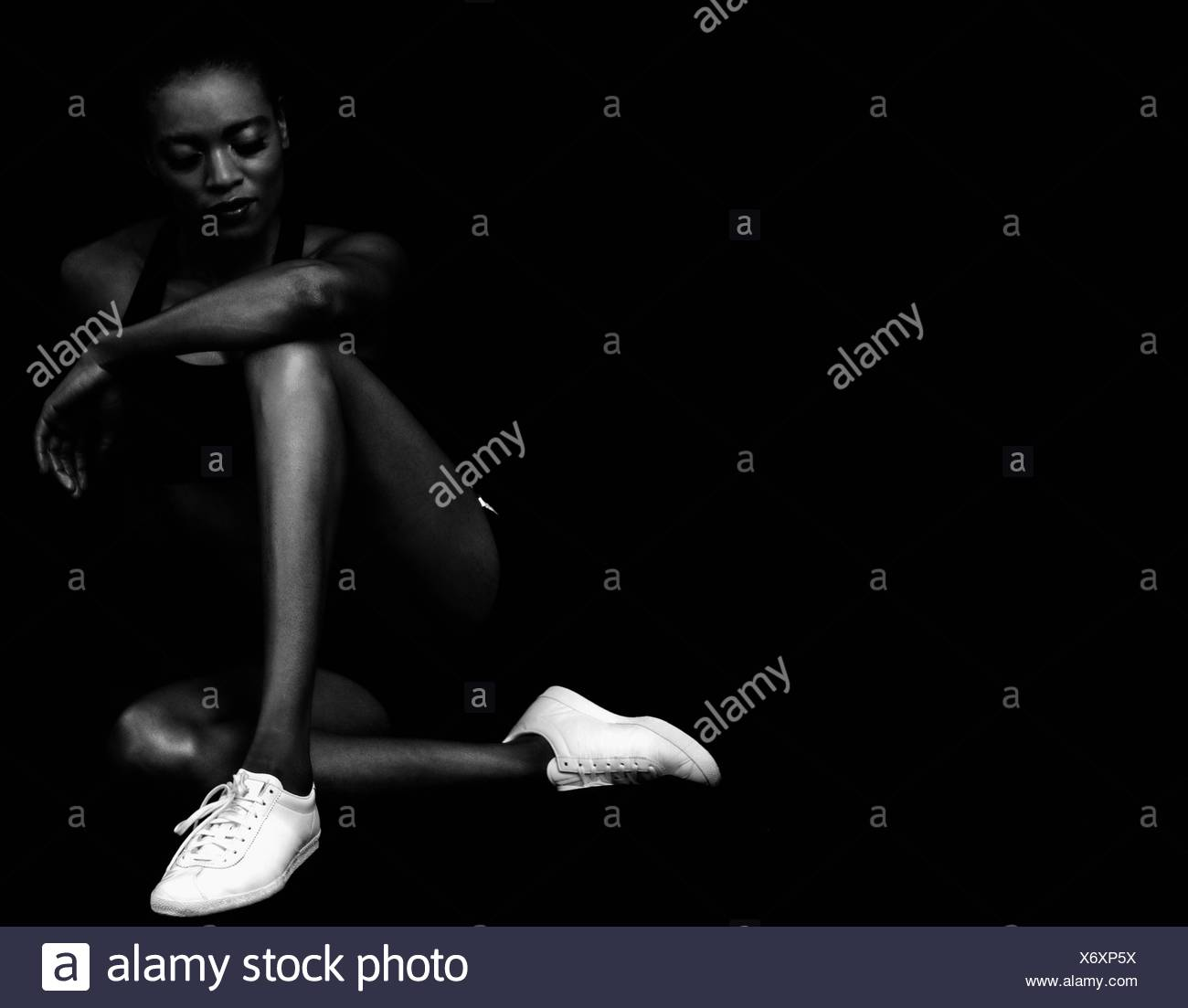 Athletic woman wearing sports shoes - Stock Image