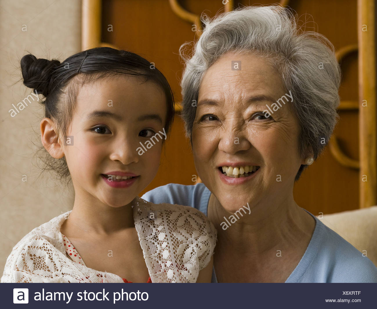 Grandmother with granddaughter smiling - Stock Image