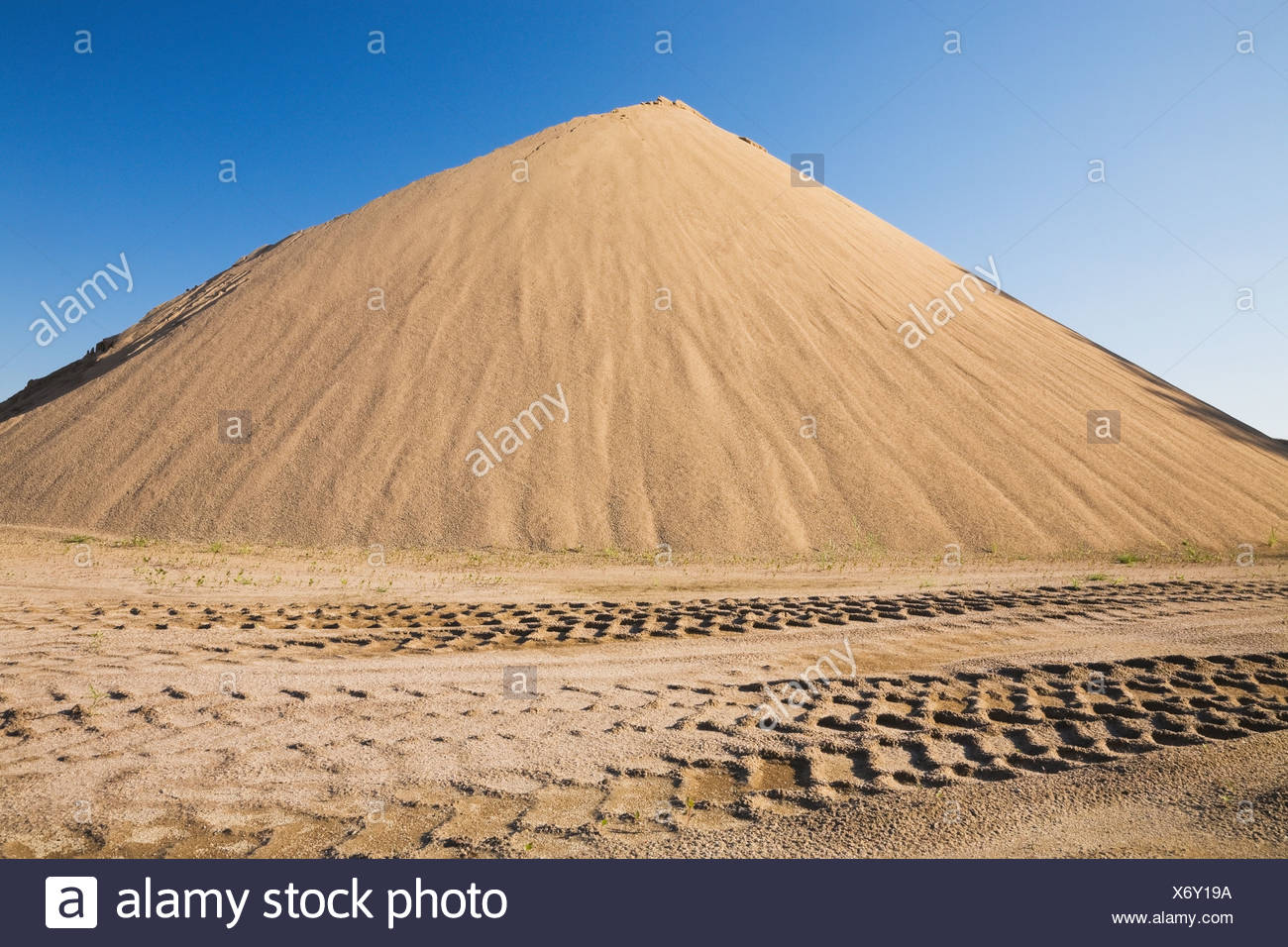 Heavy Tire Tracks And A Mound Of Sand In A Commercial Sandpit; Quebec Canada - Stock Image