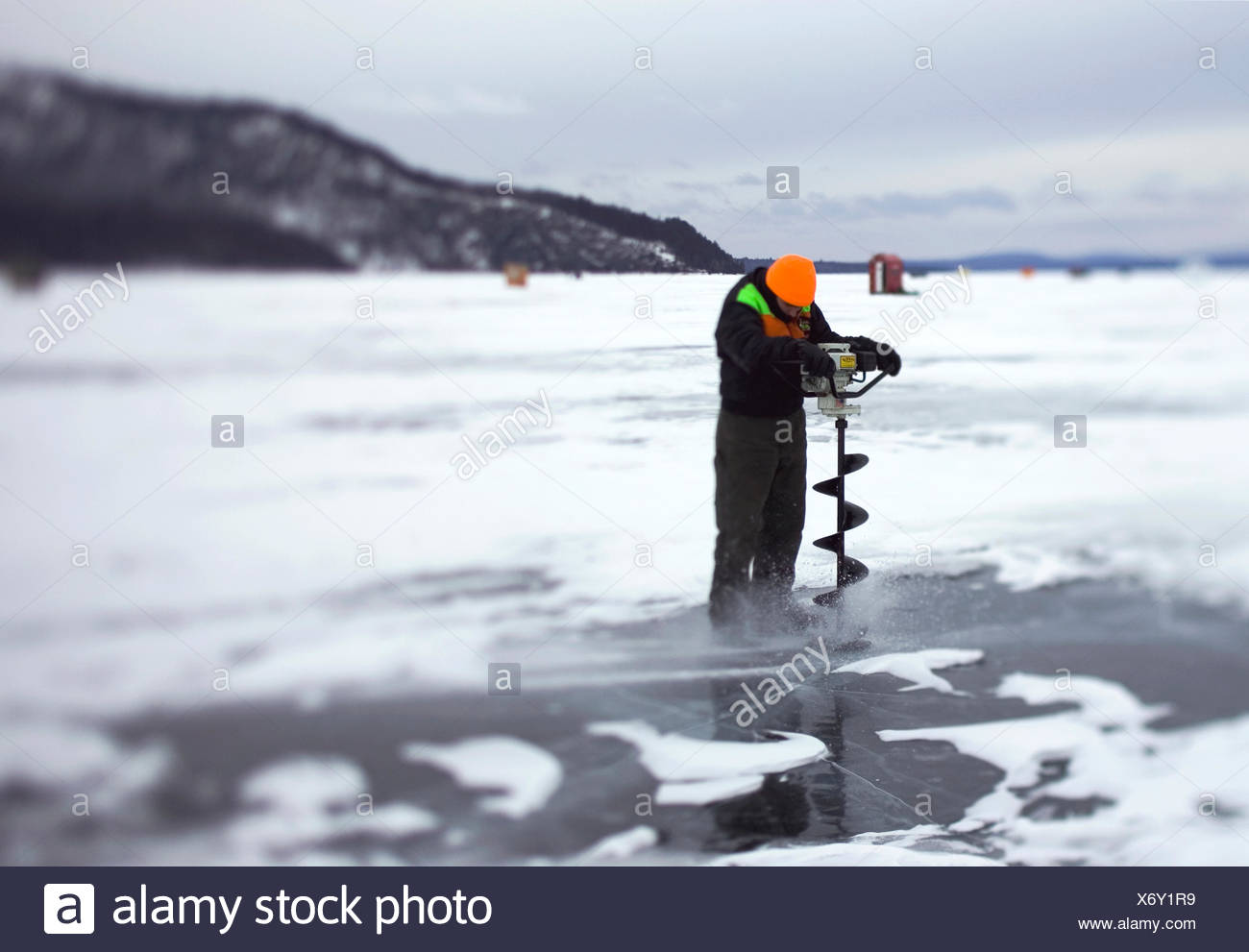 Ice Auger In Ice Stock Photos & Ice Auger In Ice Stock