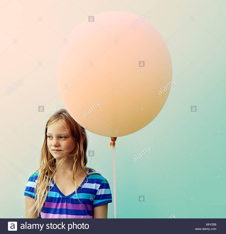 Texas, Austin, Blonde girl holding big balloon - Stock Image
