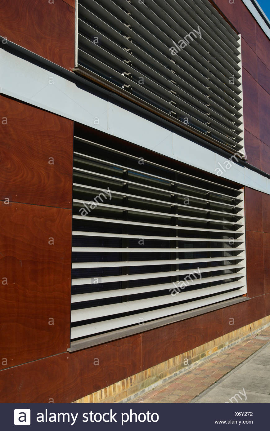Exterior window blinds on community centre Bow London UK - Stock Image