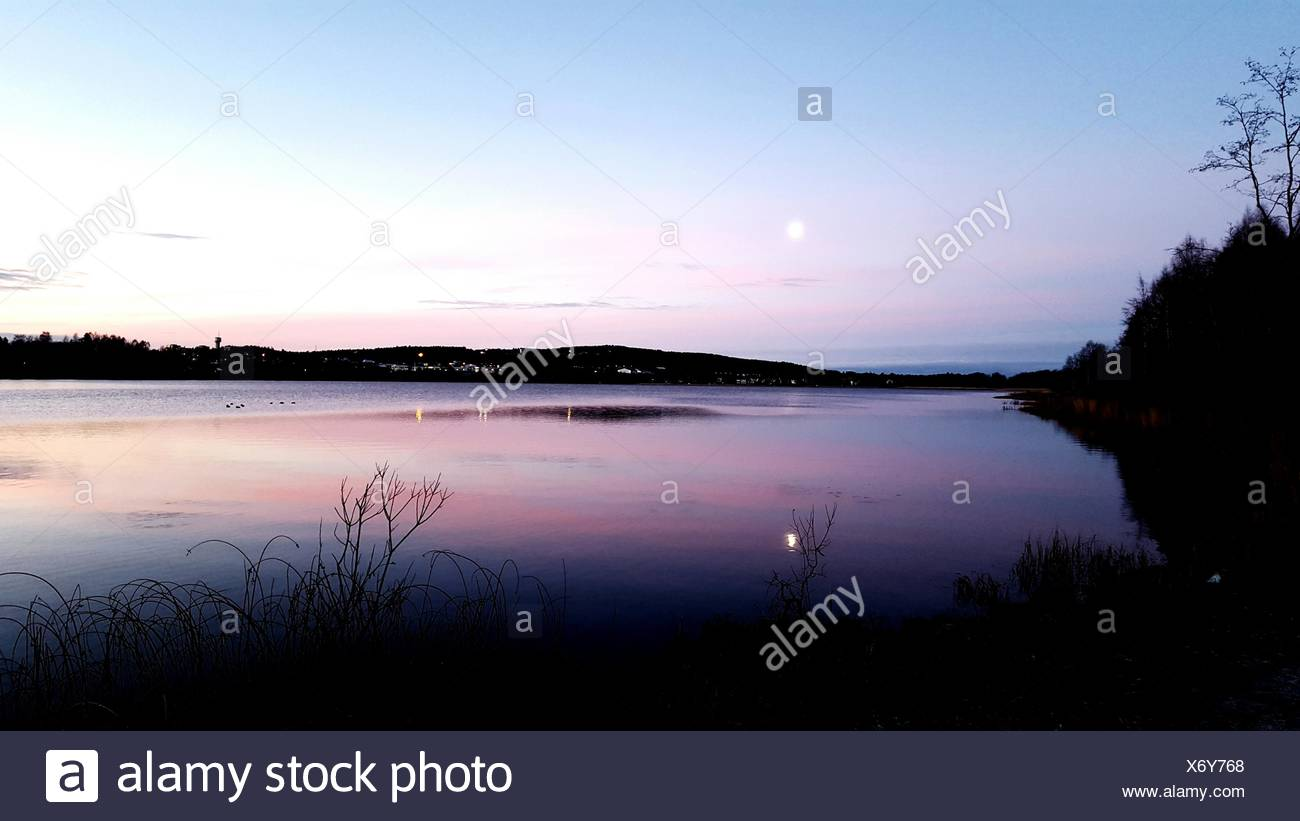 Scenic View Of Lake Against Sky During Sunset - Stock Image