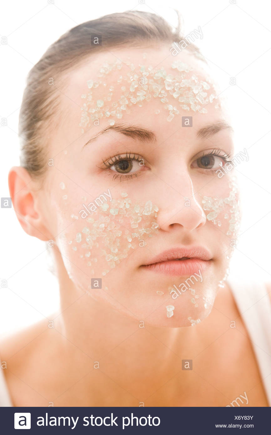 woman applying facial mask - Stock Image