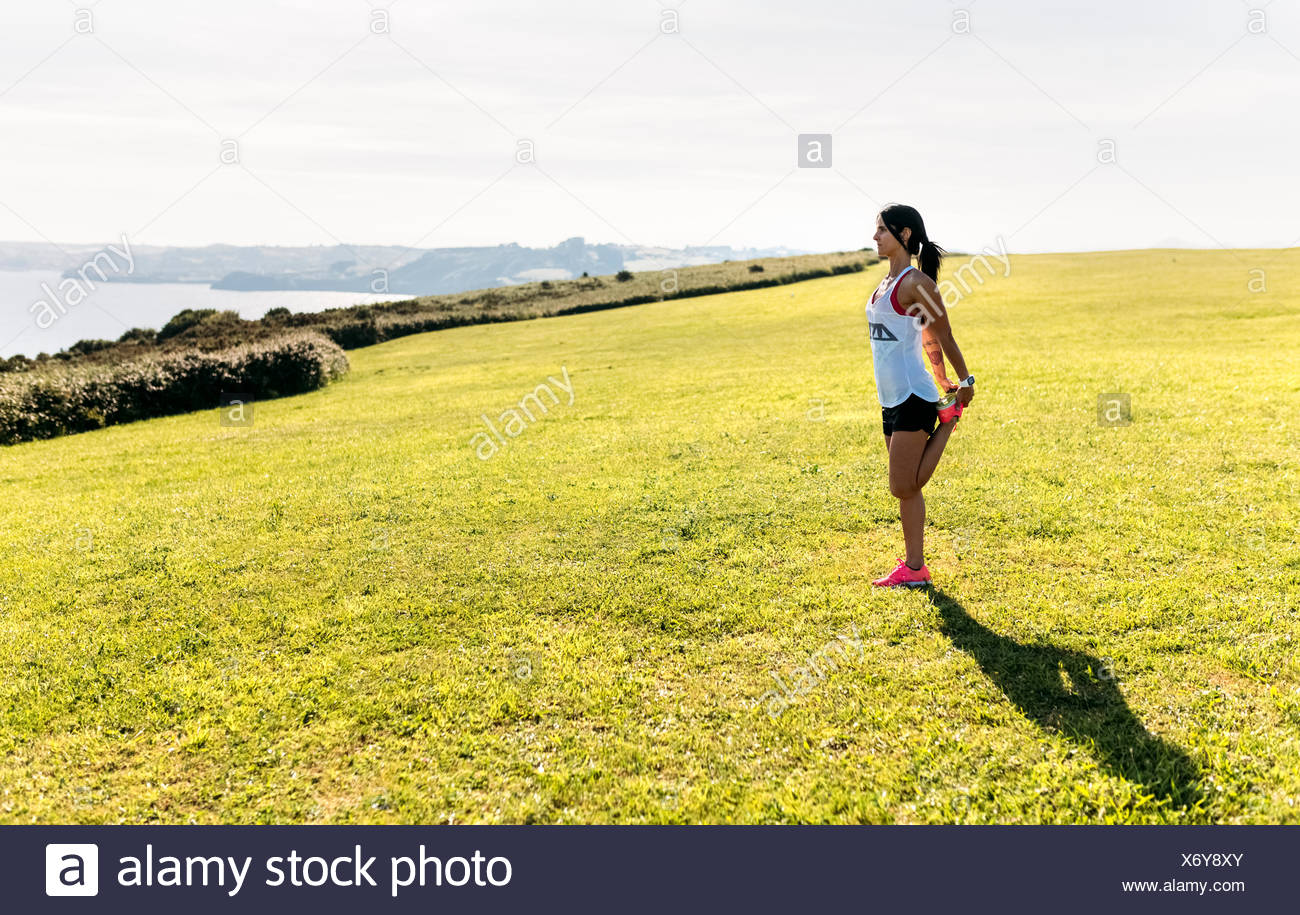 Woman doing warm up before training - Stock Image
