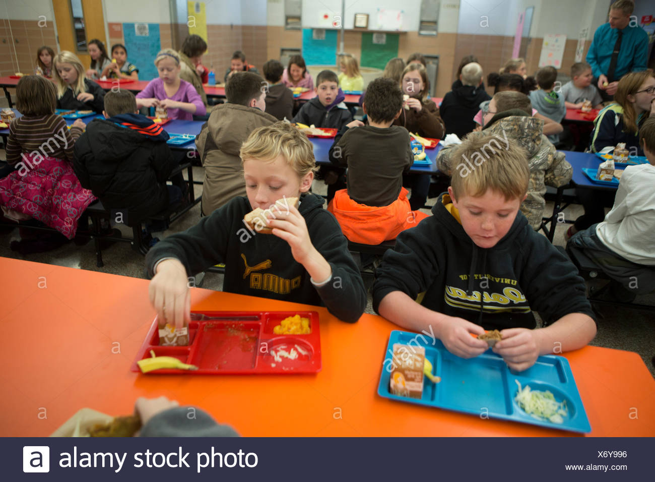 Elementary school students receive free breakfast provided by the school. - Stock Image