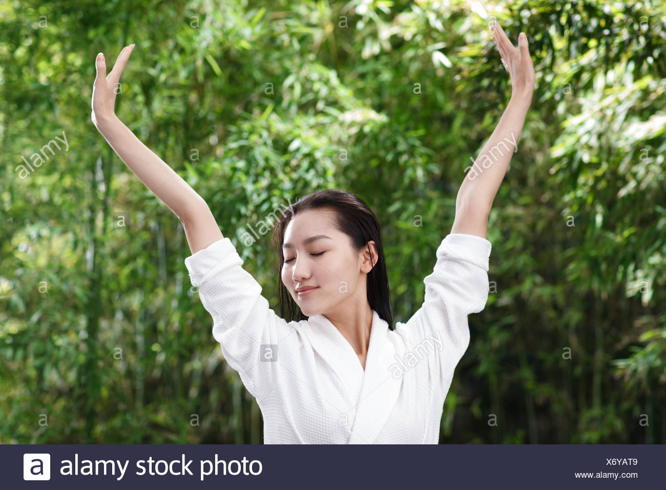 Young women for SPA stretched his arms in outdoor - Stock Image