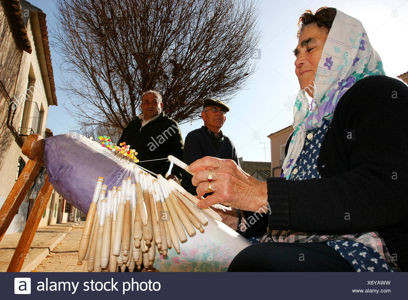 Woman making Bobbin lace. It is a craft, art yarn fabric made ??in Granátula of Calatrava. Bobbin lace that flows from the - Stock Image
