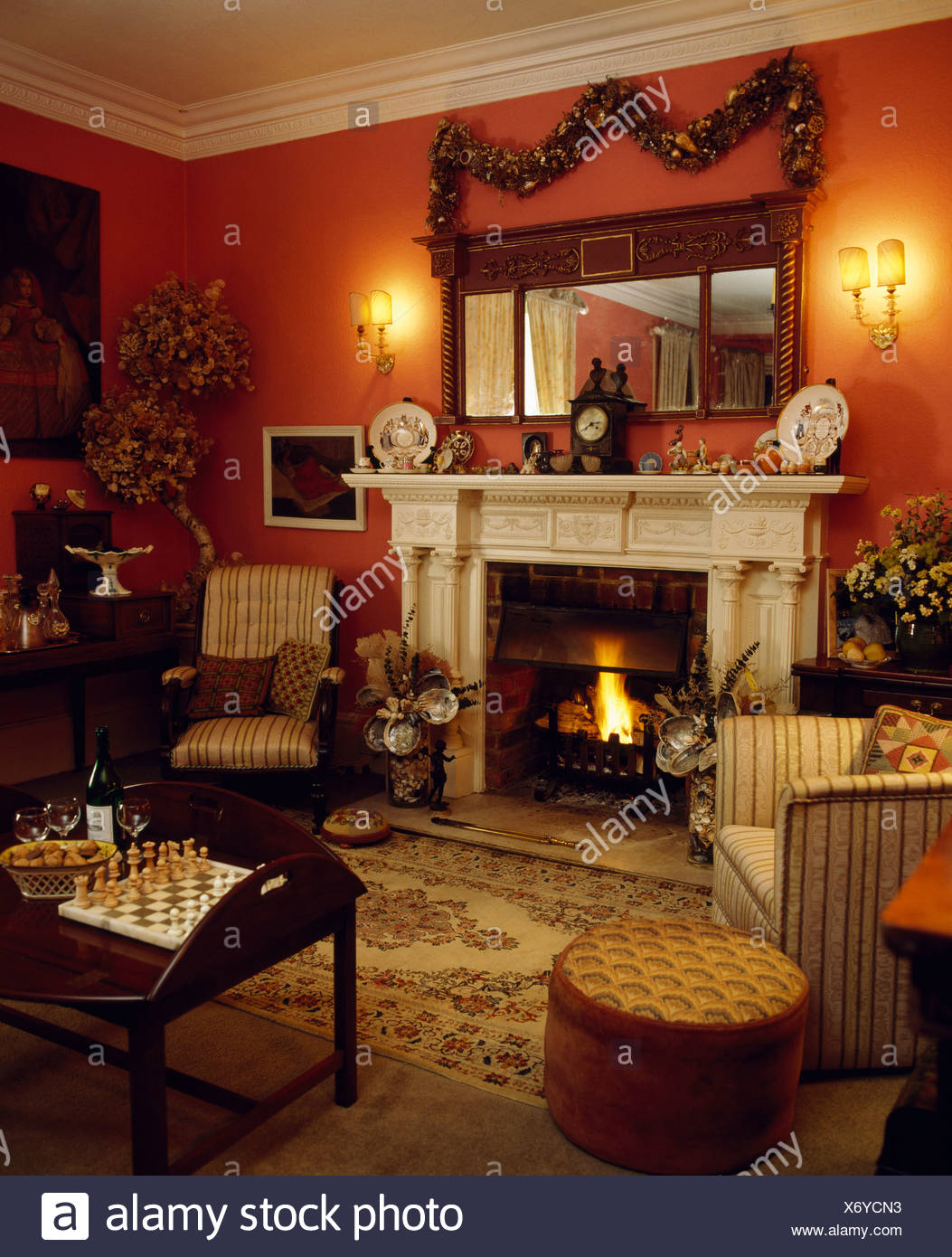 Red Livingroom Decorated For Christmas With Garland And
