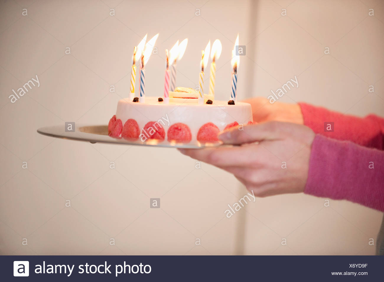 Close Up Of A Womans Hands Holding Birthday Cake Stock Photo
