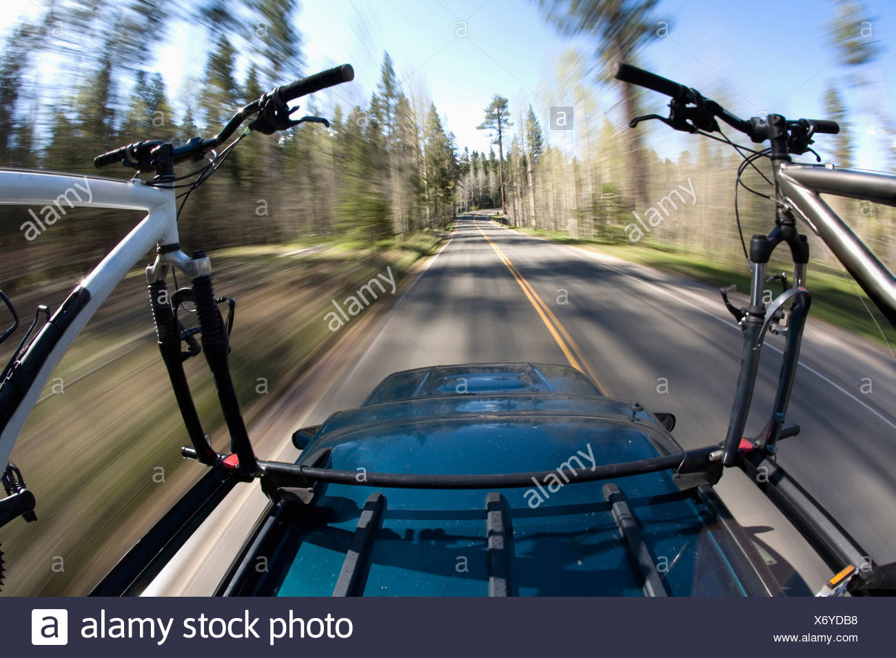 Blurred image of mountain bikes on a roof rack near Lake Tahoe, California. - Stock Image
