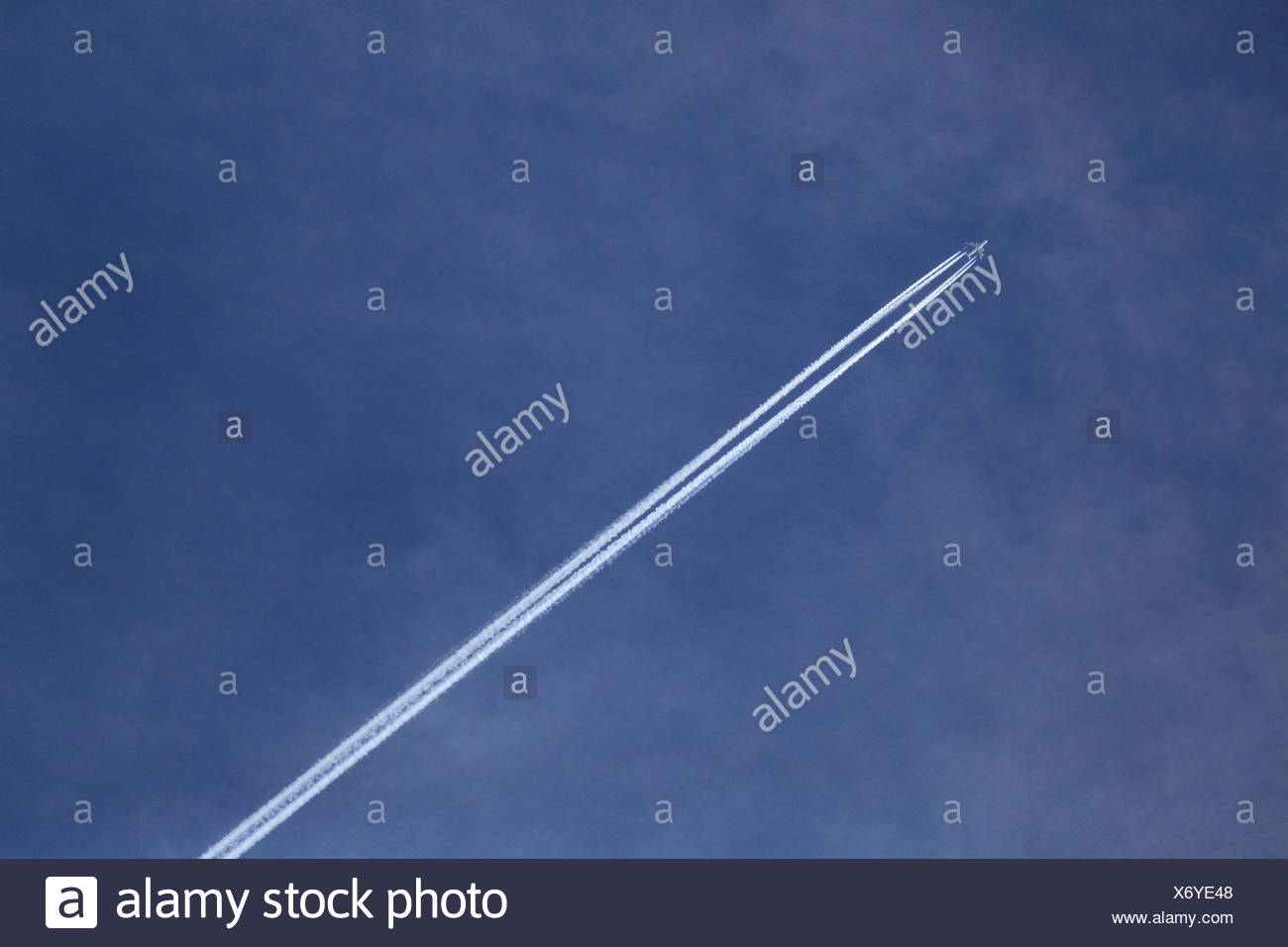Jet plane with condensation trails - Stock Image