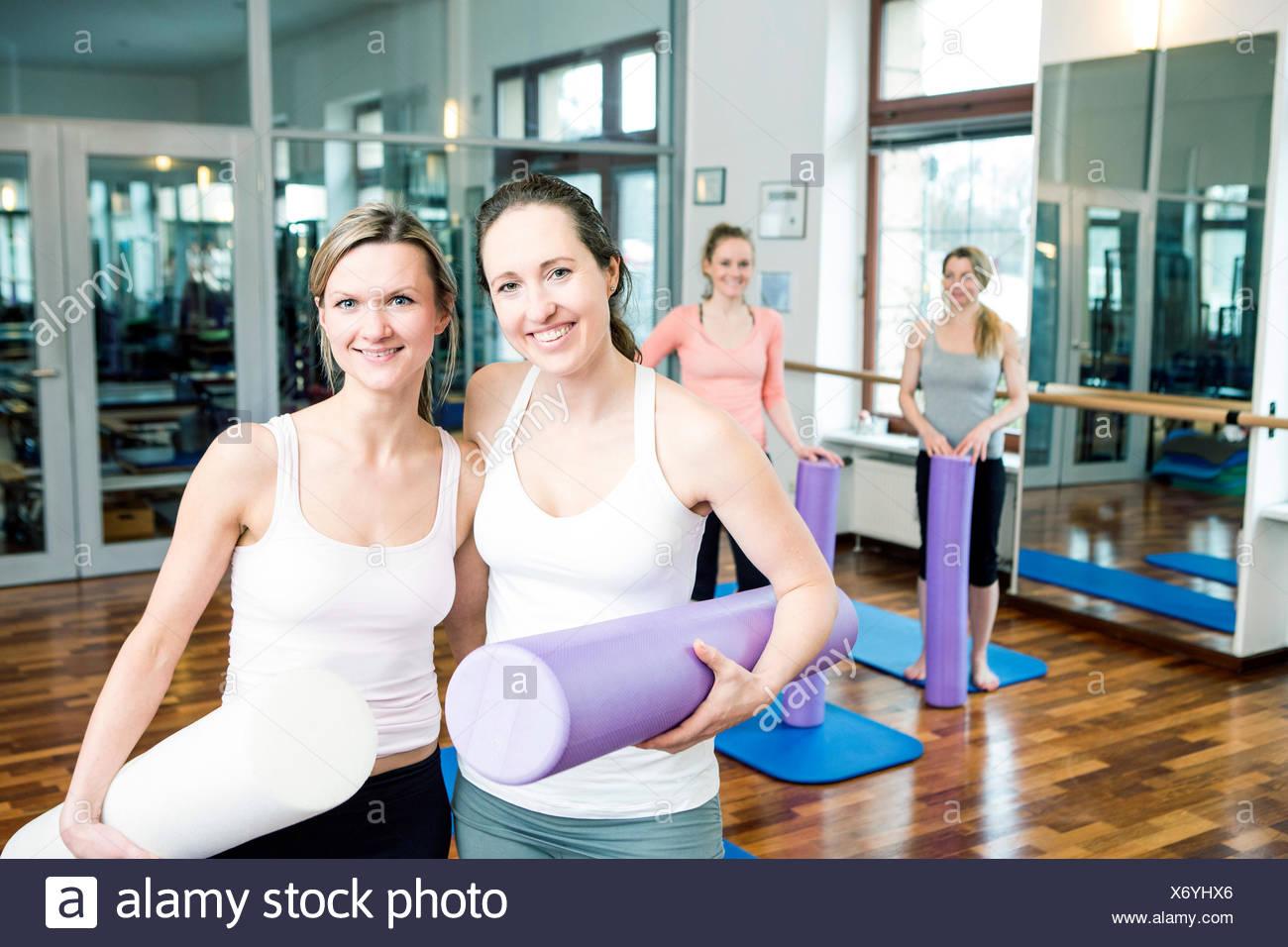 Women take a break on Pilates class - Stock Image