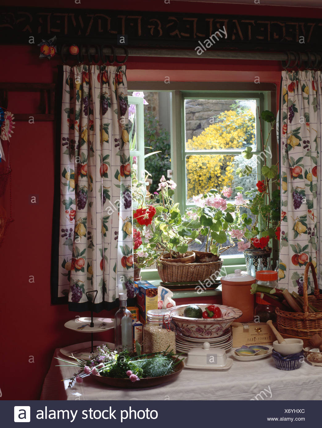 Close Up Of Floral Curtains On Green Cottage Window Above Kitchen Worktop With Pestle And Mortar And Ceramic Pots Stock Photo Alamy