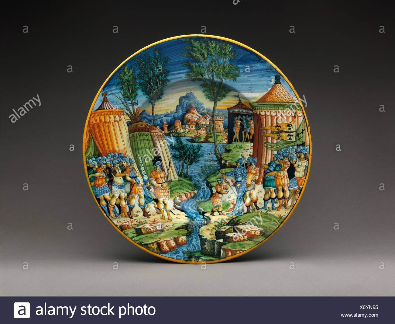 Dish or plate with Hannibal Encountering Roman Troops in Italy. Artist: Probably workshop of Guido Durantino (Italian, Urbino, active 1516-ca. 1576); - Stock Image