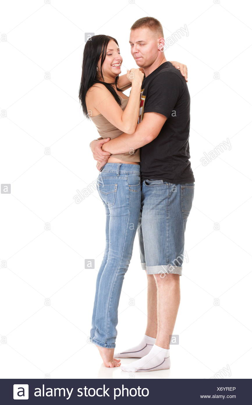 Portrait of a beautiful young happy smiling couple isolated - Stock Image