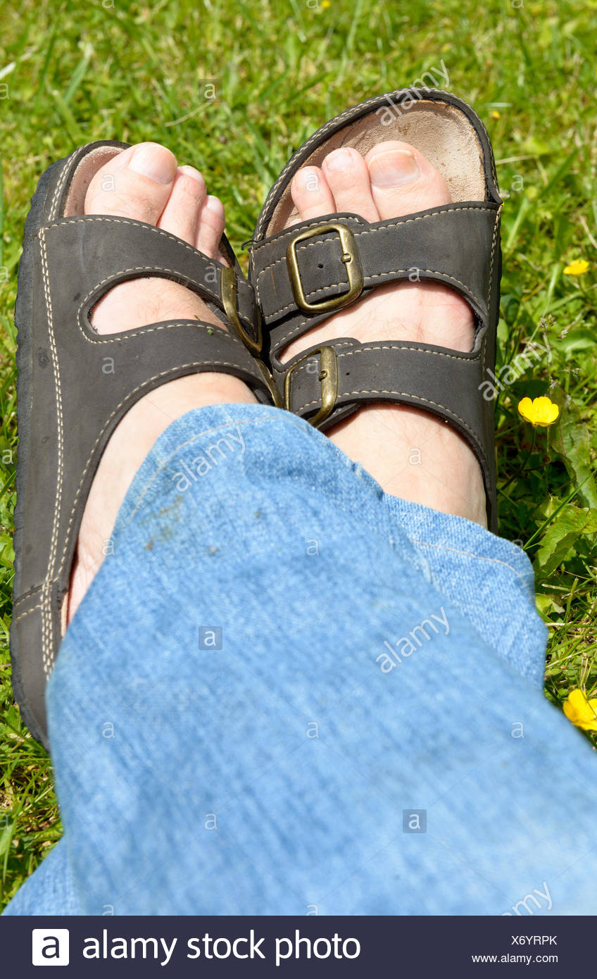man feet on grass background - Stock Image