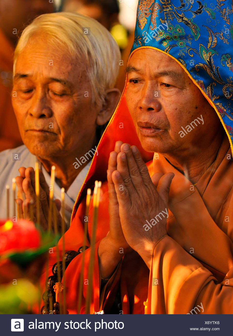 Praying high priest at the most important festival of the Cham in the Po Nagar temple, Nha Trang, Vietnam, Southeast Asia - Stock Image