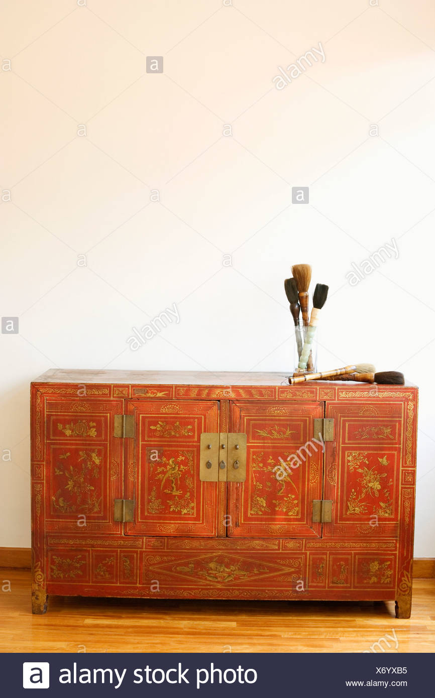 Close-up of a cabinet on a wooden laminate floor - Stock Image
