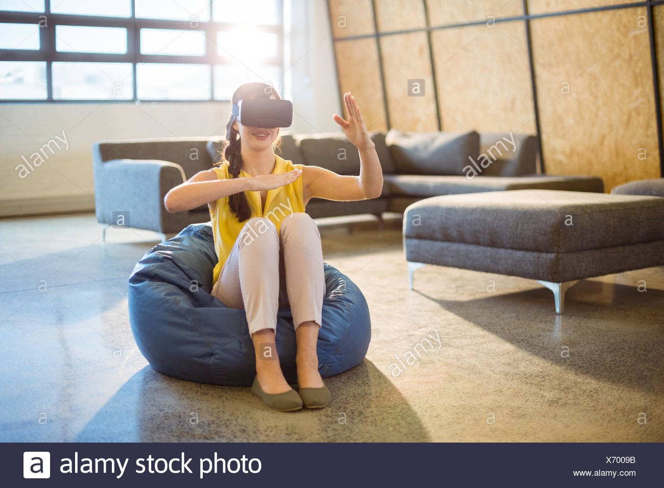 Female business executive using virtual glasses - Stock Image