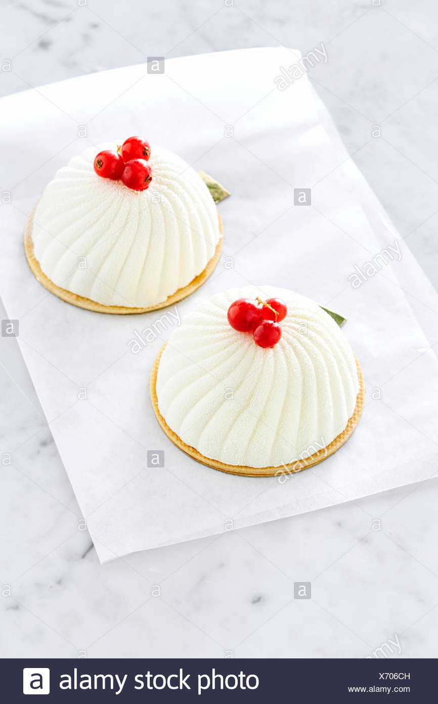 Pistachio biscuits with marzipan, raspberry coulis and mousse based on white French chocolate. Stock Photo