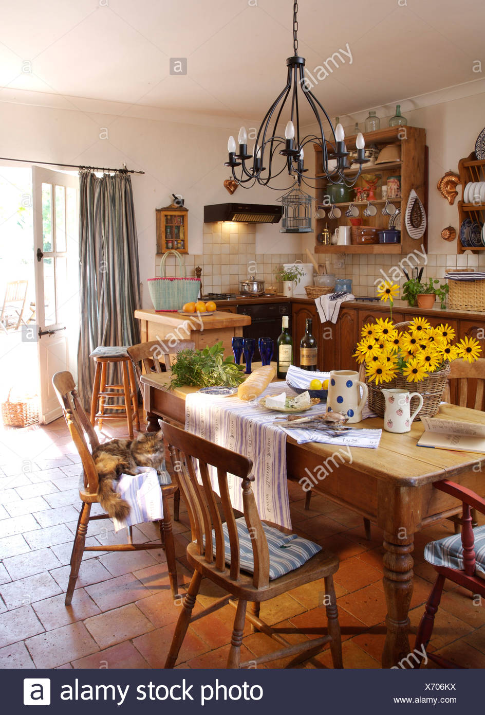 simple country kitchen. Perfect Country Metal Chandelier Above Pine Table And Simple Wooden Chairs In French Country  Kitchen With Terracotta Tiled Floor In Simple Country Kitchen V
