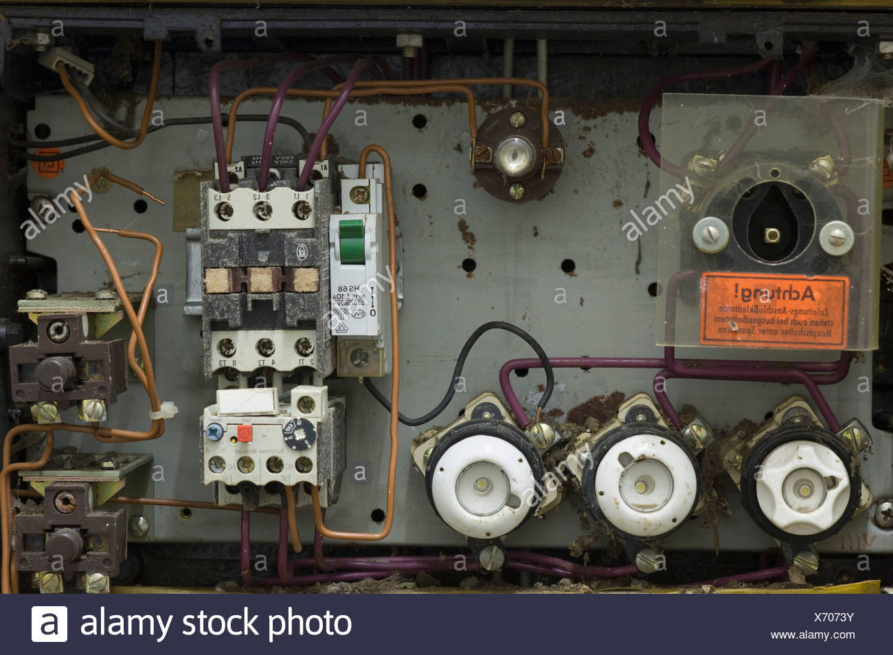 Germany, Antique old ruined fuse box - Stock Image