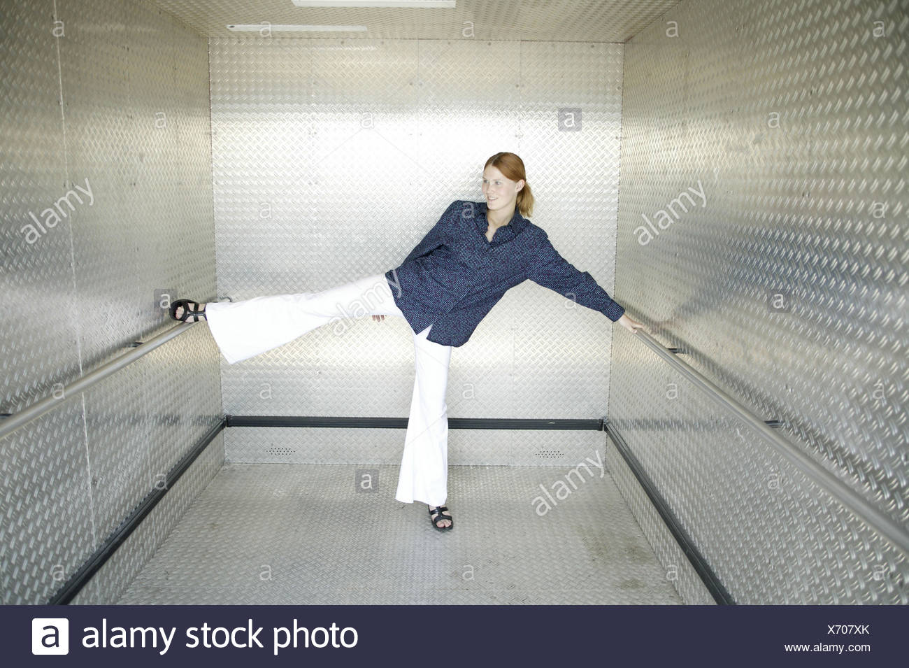 Lift, woman, young, motion, stretch, 15 stick - 20 years, young persons, trainees, trainee, lift, lift, handrail, try out, test, distension exercises, abilities, range, occupational entrance, skill, mobility, inside - Stock Image