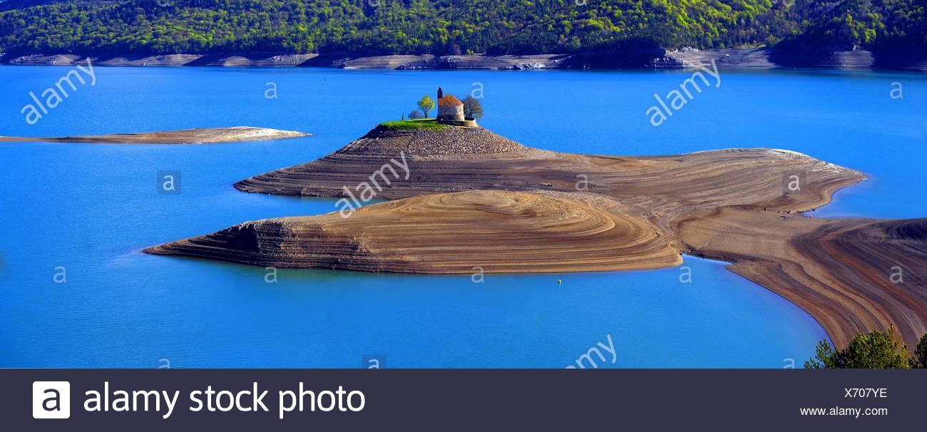 little church of Saint Michel in the artificial lakeLac de Serre-Poncon, France, Hautes-Alpes Stock Photo