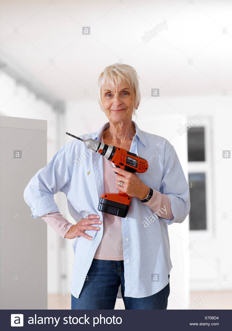 Flat renovation works senior drill smile renovate detail woman flat renovation works senior drill smile renovate detail woman pensioner do it yourselfer actively fit agile old person retirement age solutioingenieria Gallery