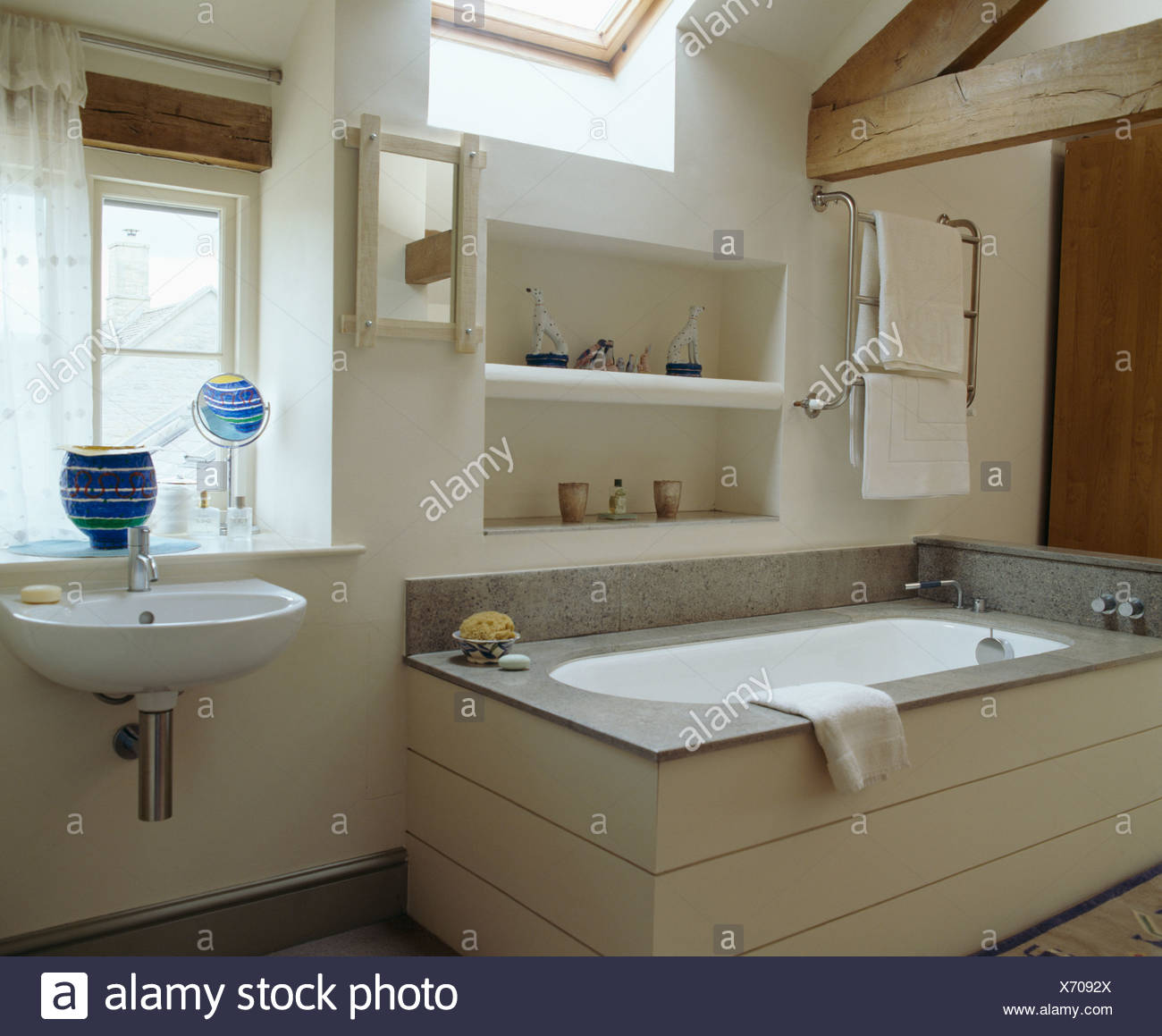 Alcove Shelving Above Bath With Granite Edging In Modern White Barn  Conversion Bathroom