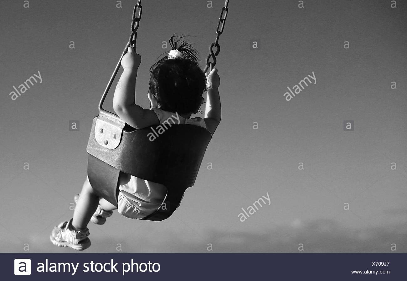 View Of Girl Swinging - Stock Image