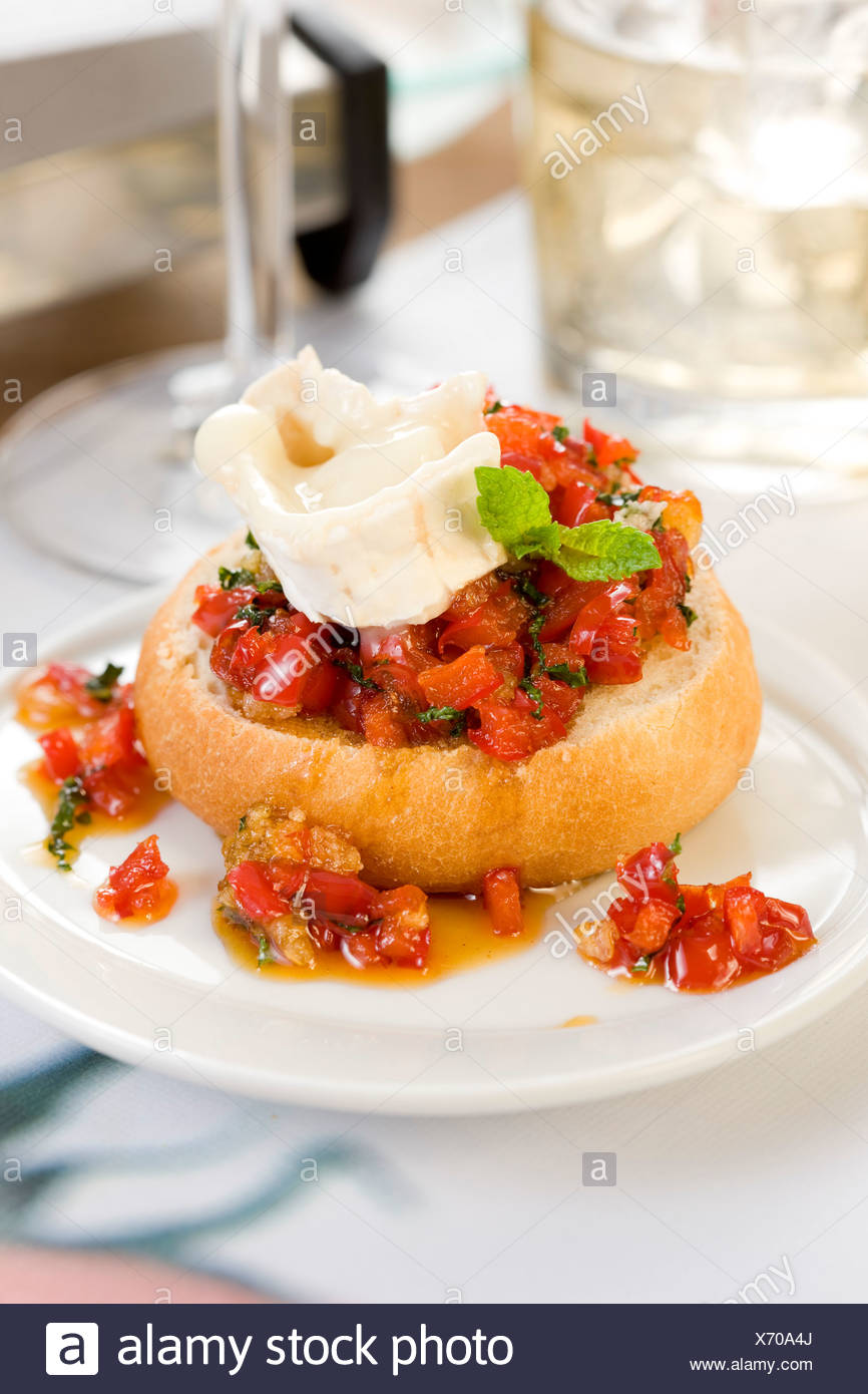 Goat's cheese and preserved tomato open sandwich - Stock Image