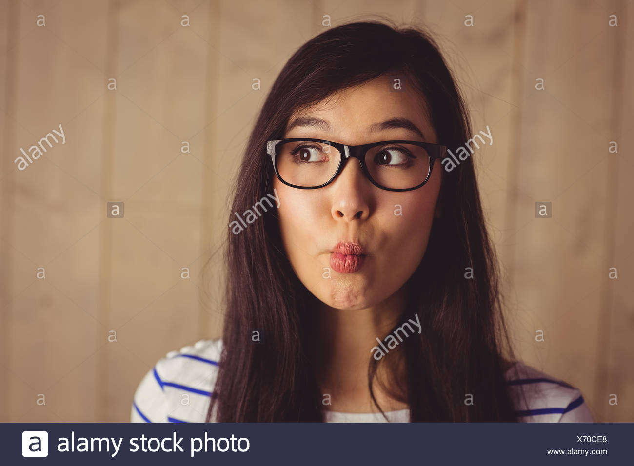 Young attractive woman grimacing for camera - Stock Image