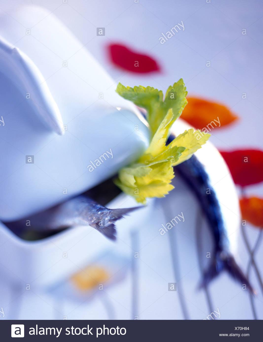 Fish tails in terrine dish - Stock Image