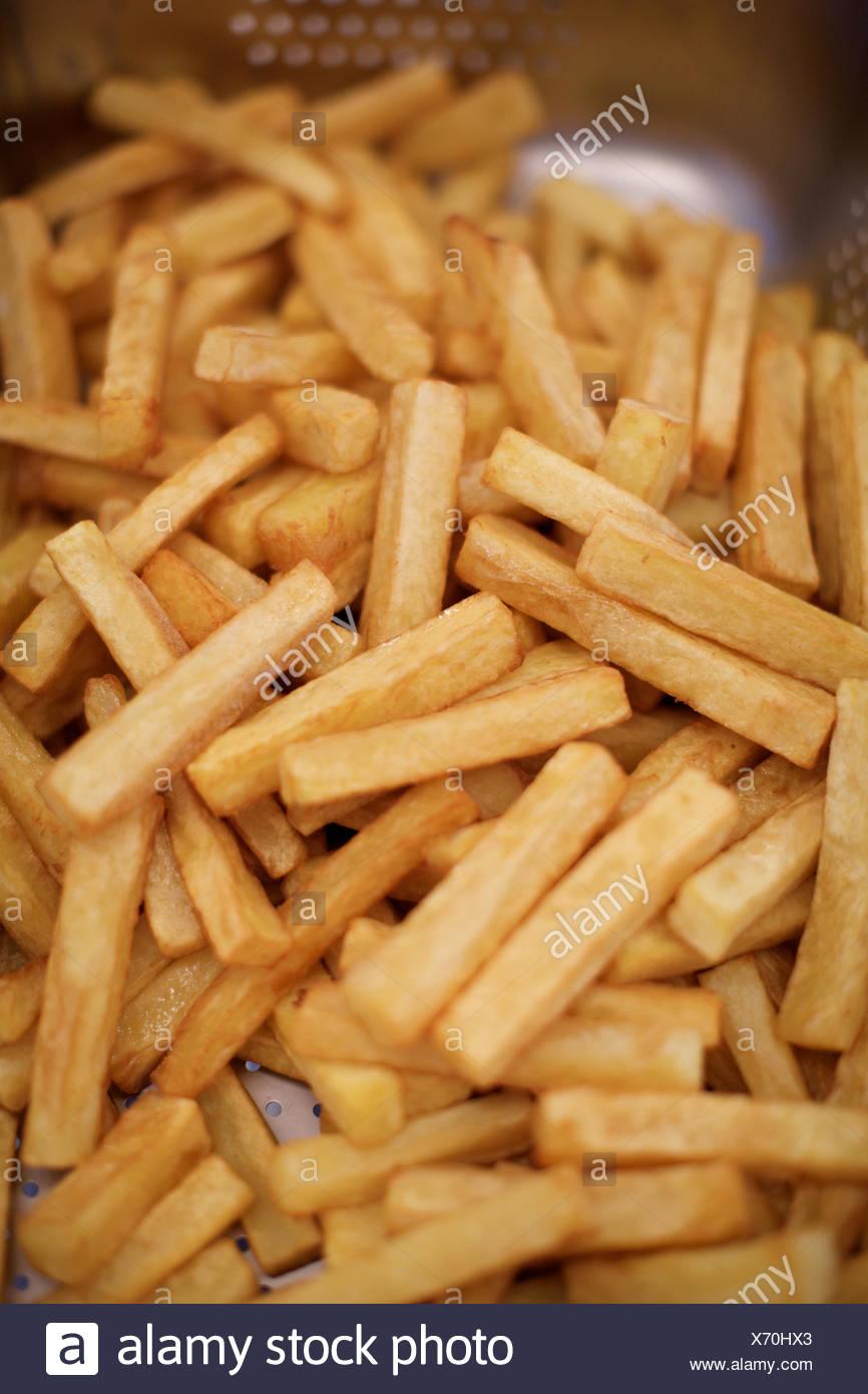 baked french fries. potato, food, fat, indulgence. - Stock Image