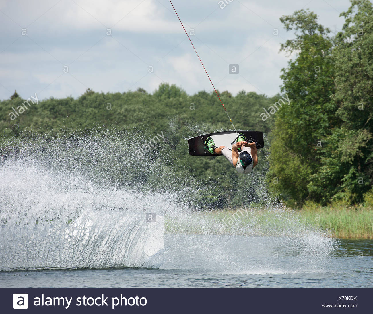 Man wakeboarding on a lake, Lithuania - Stock Image