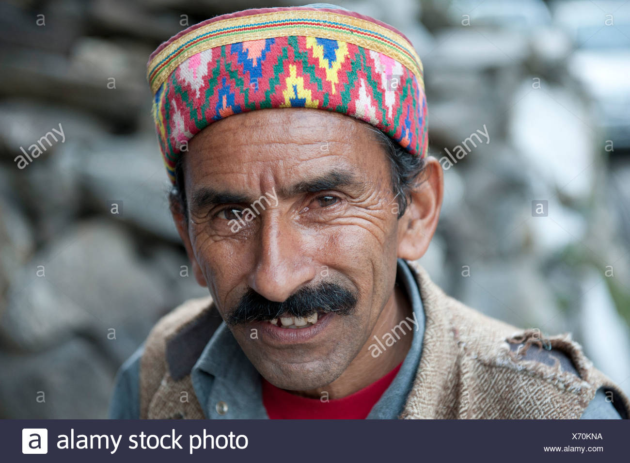 Portrait, Man wearing a typical brightly coloured decorated cap, Manali, Kullu district, the Himalayas, Himachal Pradesh, India Stock Photo