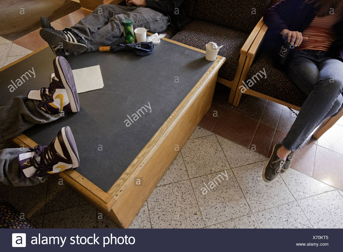 High school students in the commons area take a break at the Paideia School, Atlanta Georgia. - Stock Image