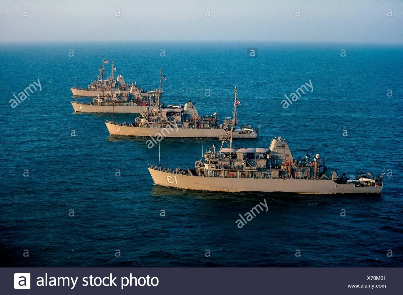 ARABIAN GULF (Dec. 6, 2016) The Avenger class mine countermeasure (MCM) ships USS Dextrous (MCM 13), USS Gladiator (MCM 11), USS Devastator (MCM 6), - Stock Image