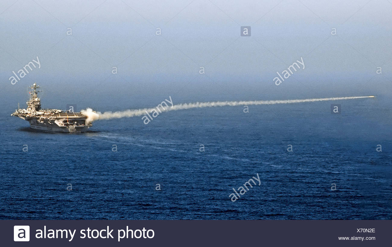 USS Abraham Lincoln Launches Missile - Stock Image