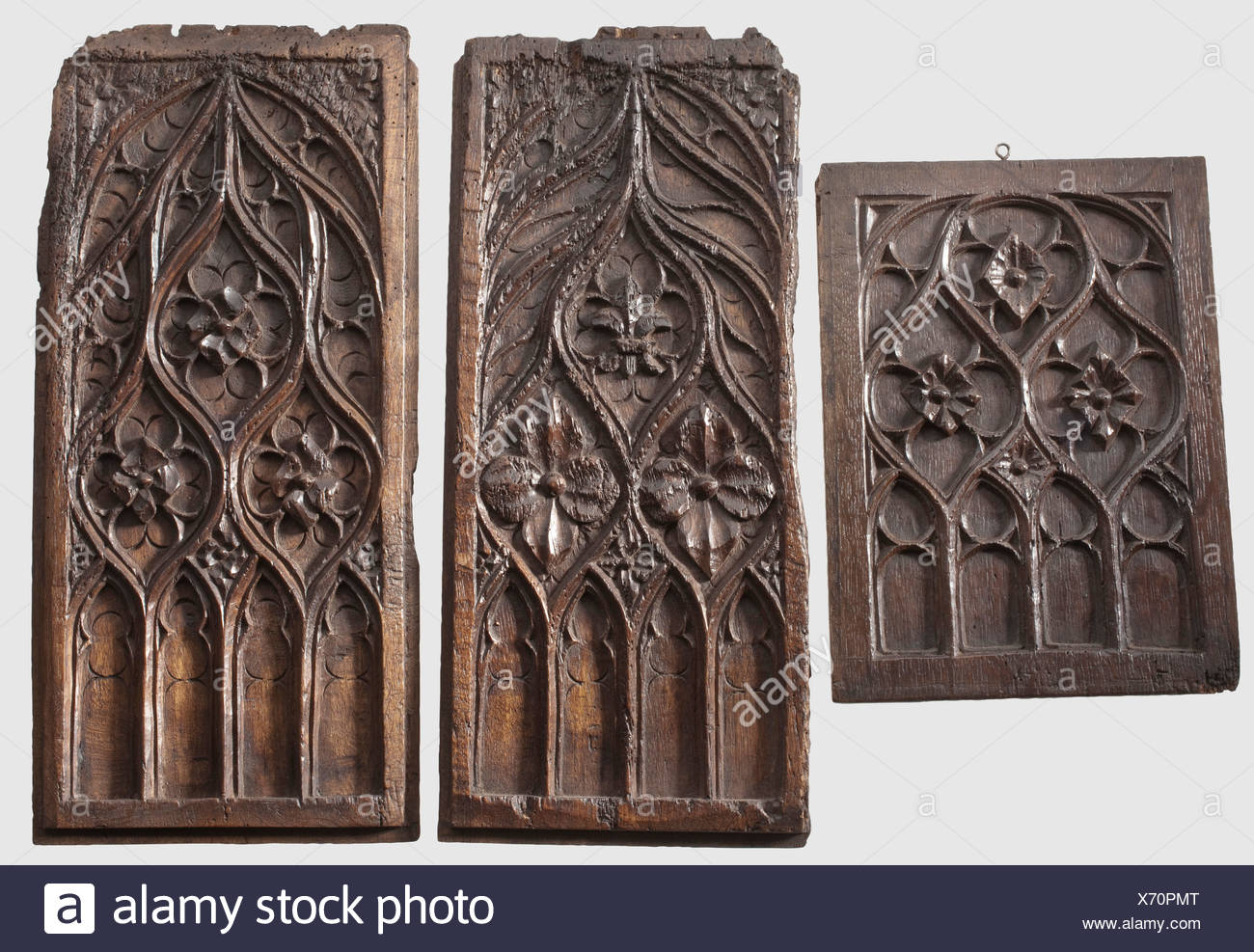 Three German or French Gothic Panels, around 1500 Carved oak with a beautiful aged patina. One pair of tall rectangular furniture panels with decorative tracery, and a similar, smaller piece. Minor defects, wormholes in places. Dimensions 49 x 22.5 and 32 x 23.5 cm, historic, historical, 16th century, handicrafts, handcraft, craft, object, objects, stills, clipping, clippings, cut out, cut-out, cut-outs, Additional-Rights-Clearences-NA - Stock Image