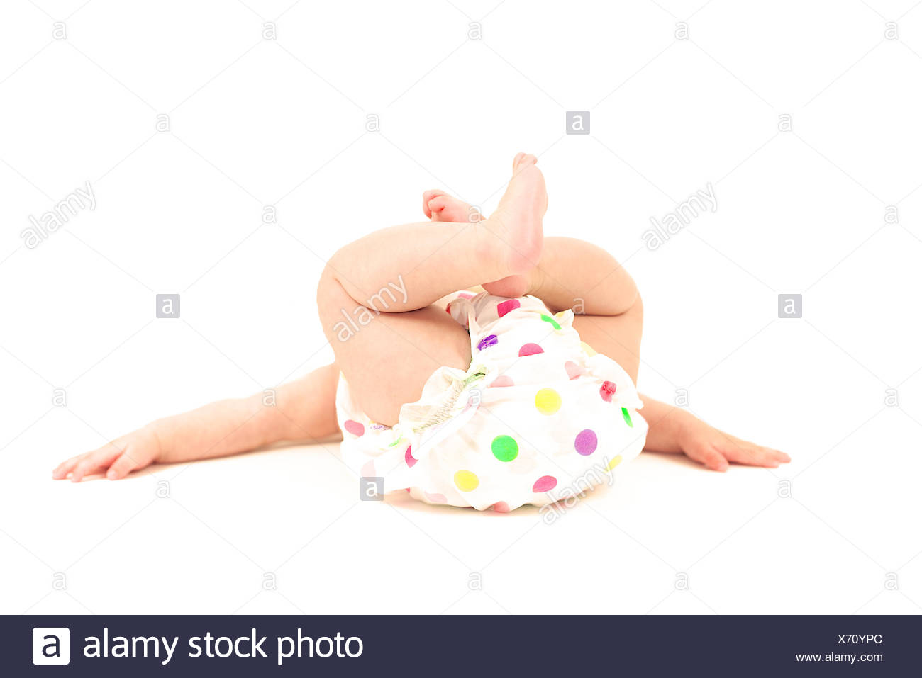 Baby (6-11 months) in spotty nappy pants - Stock Image