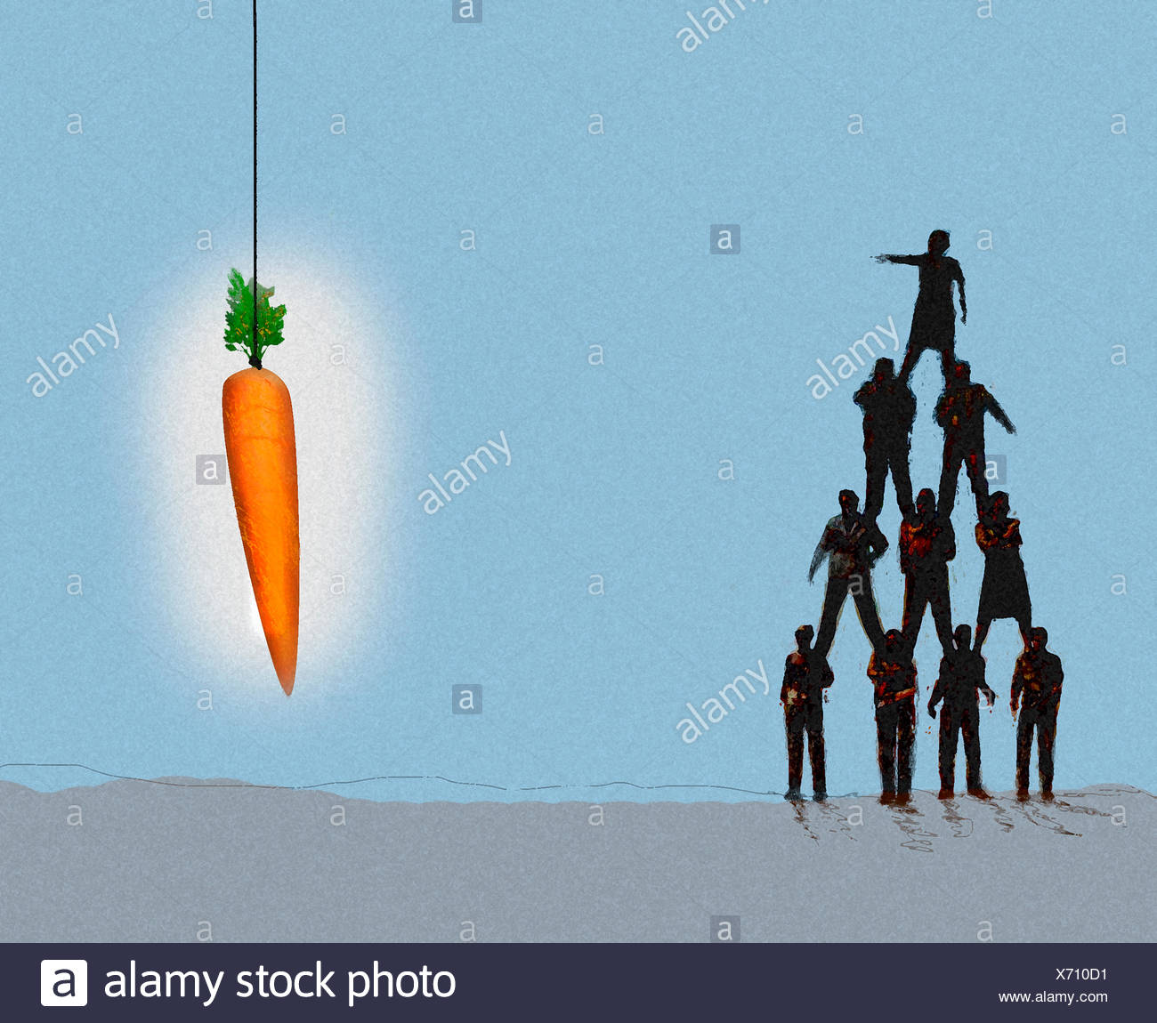Woman on top of human pyramid pointing to large carrot dangling - Stock Image