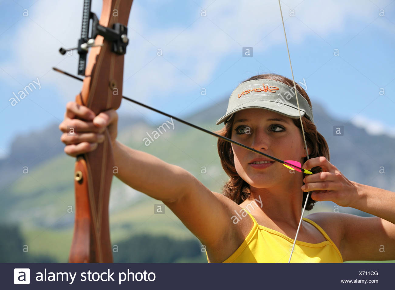 archery Outside curves arrow sighting woman weapon arms firearm sports precision sport shooter archer bow - Stock Image