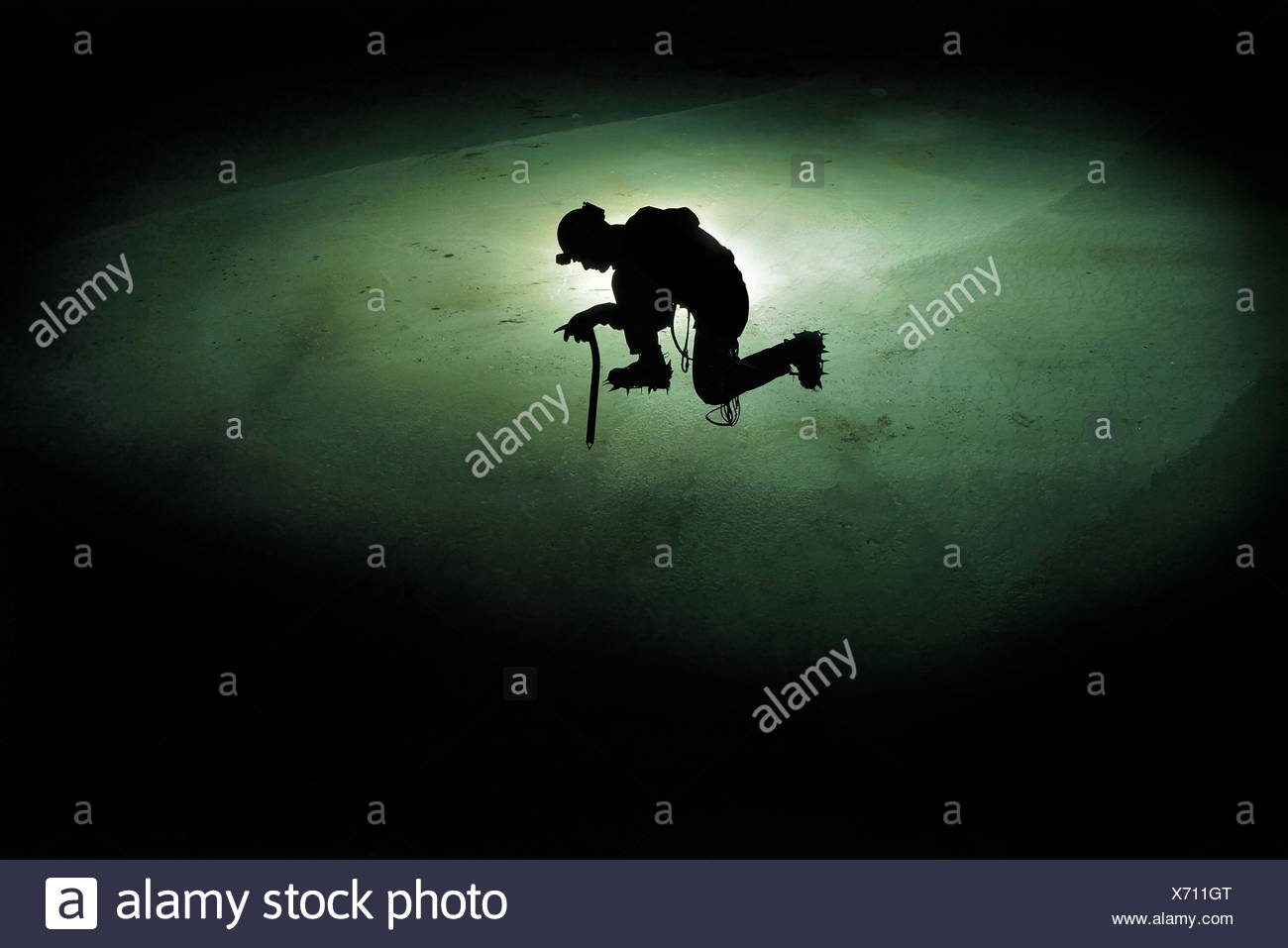 A scientist searches for tiny samples that he can extract from Schwarzmosskogel and later date in the laboratory. - Stock Image
