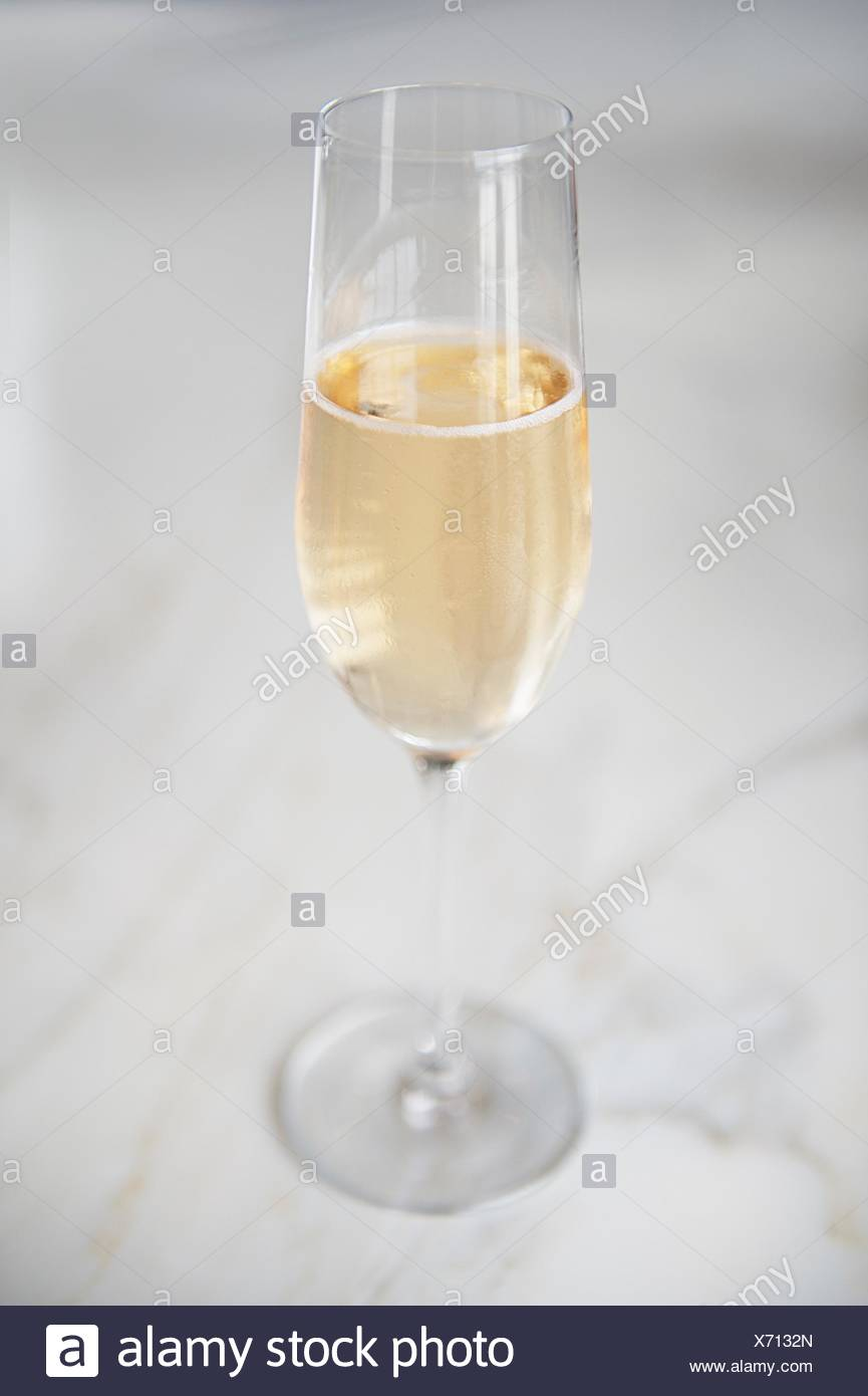 Close-Up Of Champagne Flute On Table - Stock Image