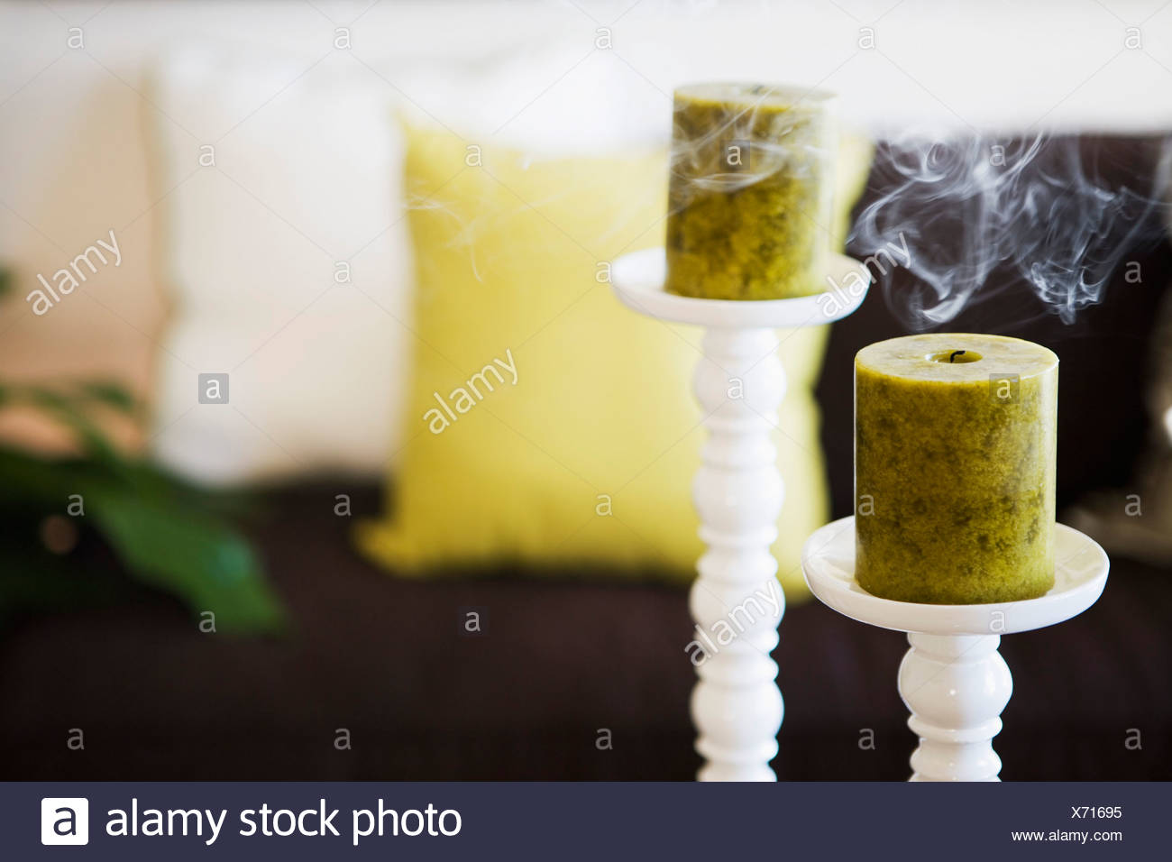 Two Unlit Candles with Smoke on Tall Candlesticks - Stock Image